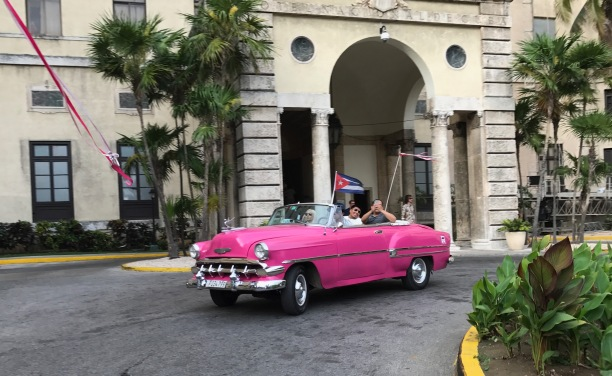 Students ride in classic taxis to a farewell dinner