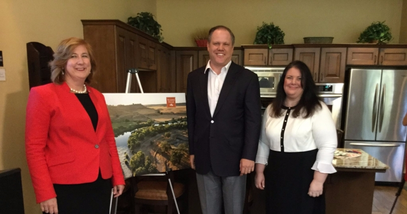 Interim dean Michelle DenBeste, Geography Department chair Michelle Calvarese and McCaffrey Group president Brent McCaffrey pose for a photo